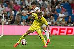 Villarreal's Samu Castillejo and Real Madrid's James Rodriguez during the match of La Liga between Real Madrid  and Villarreal Club de Futbol at Santiago Bernabeu Estadium in Madrid. September 21, 2016. (ALTERPHOTOS/Rodrigo Jimenez)