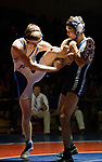 Carson's Kyle Sharp, right, lifts the leg of McQueen's Mike Paulk during their 120 pound weight class match as part of the Division 1 NIAA Region Wrestling Championship on Saturday afternoon, February 2, 2013 at Reno High School.  Sharp won the match.