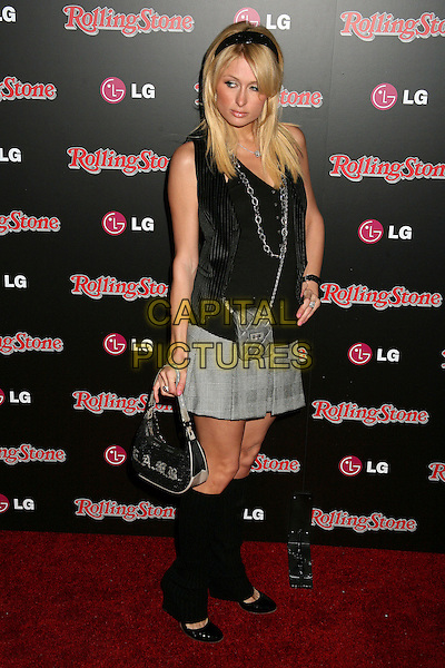 PARIS HILTON.Rolling Stone Magazine Celebrates the 20th Annual HOT LIST at the Sofitel Hotel's Stone Rose Lounge, Los Angeles, California, USA..October 3rd, 2006.Ref: ADM/BP.full length top legwarmers le warmers grey gray skirt hand on hip black alice band.www.capitalpictures.com.sales@capitalpictures.com.©Byron Purvis/AdMedia/Capital Pictures.