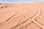 Coral Pink Sand Dunes State Park, Kanab, Utah; tire tracks from off-highway vehicles (OHV) create a figure 8 pattern in the sand