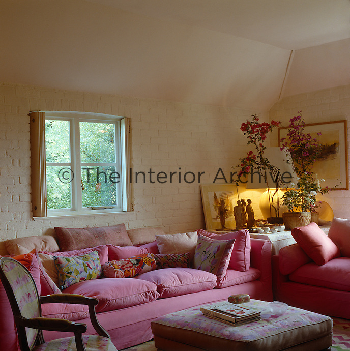 The Indian sitting room takes its name from the hot pink of the sofas and the watercolours and objects in it