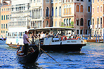 A Vaporetto with a Gondola on the Grand Canal in Venice.