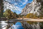 Merced River reflects the massive granite walls as seen from Stoneman Bridge.
