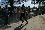 February 13, 2004. Cap Haitian, Haiti. A road block set by the pro aristide villagers in Limonade. It was said that the road from the DR to Cap Haitian is without any government of any government forces..