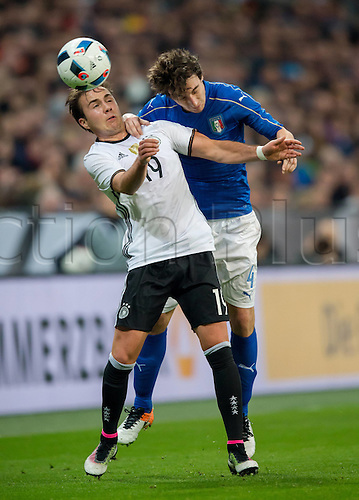 29.03.2016. Munich, Germany. International soccer match between Germany and Italy, at the Allianz Arena in Munich.  Mario Goetze (Ger) and Matteo Darmian (Ita).
