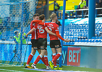 Barnsley's midfielder Harvey Barnes (15), Angus MacDonald and Barnsley's defender Jason McCarthy (2) celebrate in front of Sheffield Wednesday's Leppings lane during the Sky Bet Championship match between Sheff Wednesday and Barnsley at Hillsborough, Sheffield, England on 28 October 2017. Photo by Stephen Buckley / PRiME Media Images.