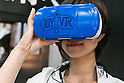 An exhibitor wears a ''JOY ! VR,'' Takara Tomy's virtual reality goggles at the International Tokyo Toy Show 2016 in Tokyo Big Sight on June 9, 2016, Tokyo, Japan. The annual exhibition showcases some 35,000 toys from 160 toy makers from Japan and overseas. The show runs to June 12th and organisers expect to attract 160,000 visitors. (Photo by Rodrigo Reyes Marin/AFLO)