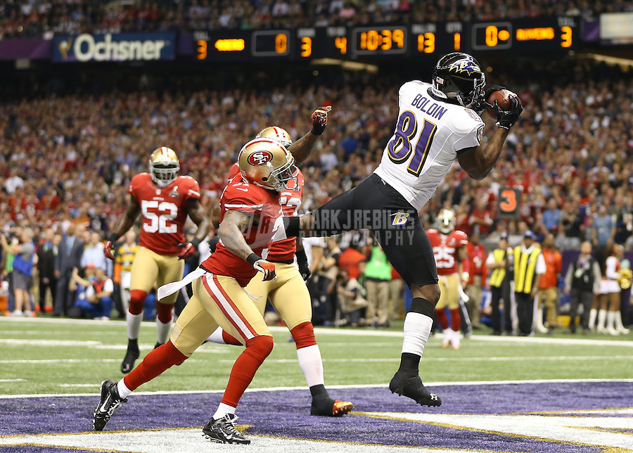 Feb 3, 2013; New Orleans, LA, USA; Baltimore Ravens wide receiver Anquan Boldin (81) catches a pass for a touchdown over San Francisco 49ers strong safety Donte Whitner (31) in the first quarter in Super Bowl XLVII at the Mercedes-Benz Superdome. Mandatory Credit: Mark J. Rebilas-