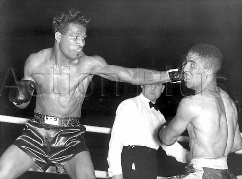 July 1951 Earls Court, London England. Sugar Ray Robinson left throwing a long left to the head of Randolph Turpin During their title bout at Earls Court in London in July 1951 when the then 23 year old Turpin from Leamington Spa toppled Robinson from his world middleweight title throne