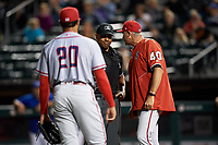 Syracuse Chiefs manager Randy Knorr (40) argues the ejection of relief pitcher Jimmy Cordero (20) with home plate umpire Jeremie Rehak during a game against the Buffalo Bisons on July 6, 2018 at Coca-Cola Field in Buffalo, New York.  Buffalo defeated Syracuse 6-4.  (Mike Janes/Four Seam Images)