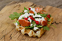 Waffle with salmon, arugula, tiny peppers and sour cream