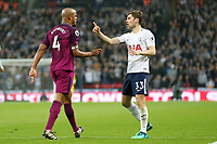 Ben Davies of Tottenham Hotspur clashes with Vincent Kompany of Manchester City during Tottenham Hotspur vs Manchester City, Premier League Football at Wembley Stadium on 14th April 2018