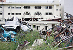 Photo shows the rear of the Shizugawa hospital, which stood close to  the Crisis Management Center in Minamisanriku Town, Miyagi Prefecture, Japan, shortly after the 11 March 2011 disasters. While the hospital and other damaged structures have recently been dismantled, the disaster prevention headquarters remains as residents and leading community figures debate the value of leaving the structure standing as a monument. Photographer: Rob Gilhooly