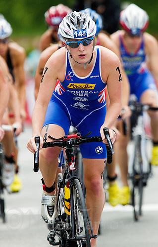 23 JUN 2012 - KITZBUEHEL, AUT - Jodie Stimpson (GBR) of Great Britain on the bike during the elite women's 2012 World Triathlon Series round in Schwarzsee, Kitzbuehel, Austria .(PHOTO (C) 2012 NIGEL FARROW)