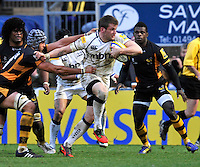 High Wycombe, England. Mark Cueto of Sale Sharks tackled during the Aviva Premiership match between London Wasps and Sale Sharks at Adams Park on December 23. 2012 in High Wycombe, England.