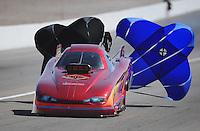 Mar. 31, 2012; Las Vegas, NV, USA: NHRA top alcohol funny car driver Mark Woznichak during qualifying for the Summitracing.com Nationals at The Strip in Las Vegas. Mandatory Credit: Mark J. Rebilas-
