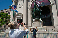 "NEW YORK CITY, NY - JUNE 22 : Rose Browne (right) gesture in triumph for a photograph in front of controversial statue of Theodore Roosevelt in front of the American Museum of Natural History on June 22, 2020 in New York City. In the context of widespread protests against racism sparked by the killing of African-American George Floyd by police, the American Museum of Natural History announced it would remove a bronze equestrian statue of Theodore Roosevelt flanked by an African and Native American man depicted in a subservient position. Ms. Browne stated,  ""I am happy the statue will come down. You know, for people like me to see this past commemorated is offensive."" This statue has long been criticized and protested by anti-racism activists for its white supremacist iconography (Photo by Stephen FerryVIEWpress)"