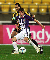 Phoenix captain Andrew Durante gets to grips with Scott Neville during the A-League football match between Wellington Phoenix and Perth Glory at Westpac Stadium, Wellington, New Zealand on Sunday, 16 August 2009. Photo: Dave Lintott / lintottphoto.co.nz