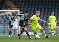 Luke O'Nien of Wycombe Wanderers heads forward under pressure from Nicky Featherstone of Hartlepool United during the Sky Bet League 2 match between Wycombe Wanderers and Hartlepool United at Adams Park, High Wycombe, England on 5 September 2015. Photo by Andy Rowland.