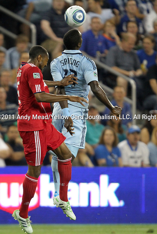 09 June 2011: Kansas City's C.J. Sapong (17) and Chicago's Cory Gibbs (5). Sporting Kansas City played the Chicago Fire to a 0-0 tie in the inaugural game at LIVESTRONG Sporting Park in Kansas City, Kansas in a 2011 regular season Major League Soccer game.