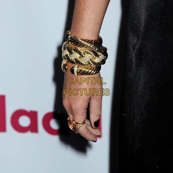 TORI SPELLING's hand .22nd Annual GLAAD Media Awards held at the Westin Bonaventure Hotel, Los Angeles, California, USA,    .10 April 2011..cuff detail gold bracelet hand ring .CAP/ADM/BP.©Byron Purvis/AdMedia/Capital Pictures.