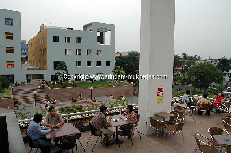 Indian people sitting at the coffee court of City Center at  Kolkata, India. Arindam Mukherjee