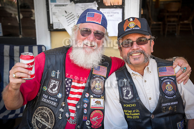 Independence Day celebration Main Street, Mokelumne Hill, California..Veterans and American Legion RIders, Amador Post 108: Denver and Poncho, toast Independence Day.