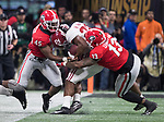 Georgia Bulldogs linebacker Reggie Carter (45) and defensive end Jonathan Ledbetter (13) combine to bring down Alabama Crimson Tide running back Najee Harris (22) in the second half of the NCAA College Football Playoff National Championship at Mercedes-Benz Stadium on January 8, 2018 in Atlanta. Alabama defeated Georgia 26-23 in overtime.  Photo by Mark Wallheiser/UPI