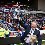 Ally McCoist with the SFL Division 3 trophy held aloft in the wind