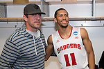 Wisconsin Badgers Jordan Hill (11) with Green Bay Packers quarterback Aaron Rodgers after  a regional semifinal NCAA college basketball tournament game against the Baylor Bears Thursday, March 27, 2014 in Anaheim, California. The Badgers won 69-52. (Photo by David Stluka)