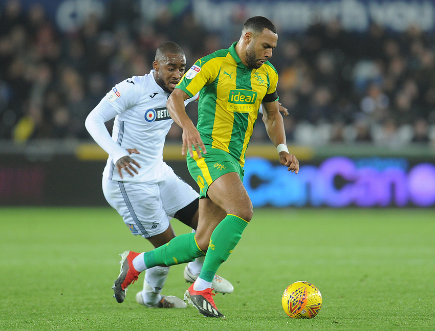 West Bromwich Albion's Matt Phillips under pressure from Swansea City's Leroy Fer<br /> <br /> Photographer Kevin Barnes/CameraSport<br /> <br /> The EFL Sky Bet Championship - Swansea City v West Bromwich Albion - Wednesday 28th November 2018 - Liberty Stadium - Swansea<br /> <br /> World Copyright © 2018 CameraSport. All rights reserved. 43 Linden Ave. Countesthorpe. Leicester. England. LE8 5PG - Tel: +44 (0) 116 277 4147 - admin@camerasport.com - www.camerasport.com