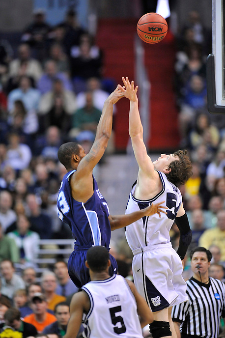 The Monarchs' Frank Hassell shoots over Andrew Smith of the Bulldogs. Butler defeated Old Dominion 60-58 during the NCAA tournament at the Verizon Center in Washington, D.C. on Thursday, March 17, 2011. Alan P. Santos/DC Sports Box
