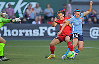 Portland, Oregon - Saturday July 2, 2016: Portland Thorns FC forward Hayley Raso (21) and Sky Blue FC defender Erin Simon (33) collide in the box during a regular season National Women's Soccer League (NWSL) match at Providence Park.