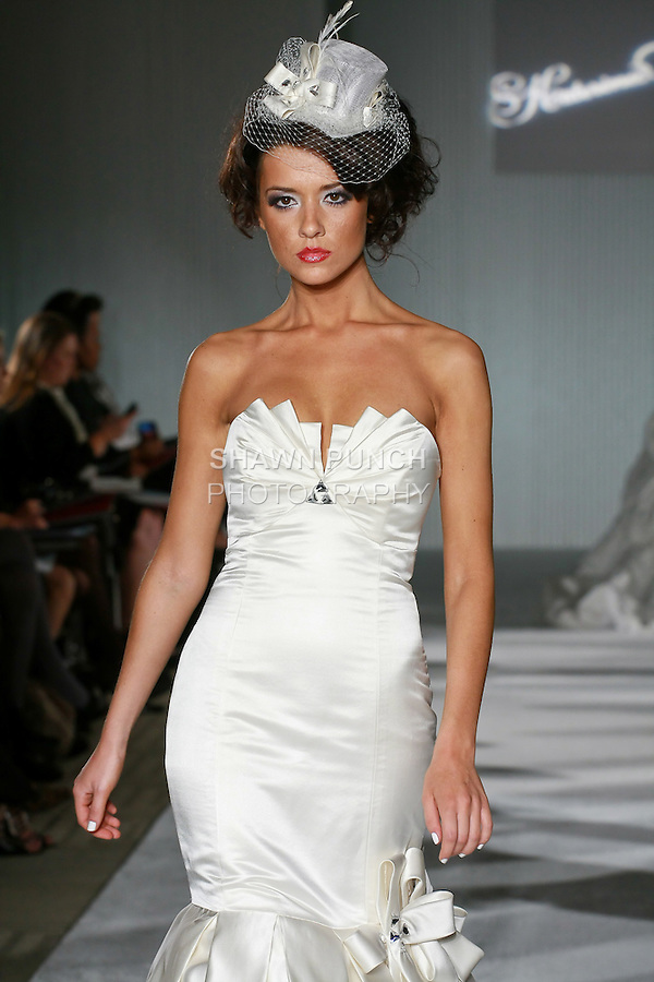 Model walks the runway in a Grace wedding dress by Katerina Bocci during the Wedding Trendspot Spring 2011 Press Fashion, October 17, 2010.