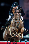 Philipp Weishaupt of Germany riding Carinou competes at the Hong Kong Jockey Club trophy during the Longines Hong Kong Masters 2015 at the AsiaWorld Expo on 13 February 2015 in Hong Kong, China. Photo by Juan Flor / Power Sport Images