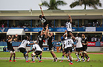 Elliot Dixon (20), is held by Jacob Skeen (4) and Blade Thomson. Maori All Blacks vs. Fiji. Suva. MAB's won 27-26. July 11, 2015. Photo: Marc Weakley