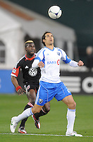 Montreal Impact forward Bernardo Corradi (23) goes against D.C. United defender Brandon McDonald (4) D.C. United tied The Montreal Impact 1-1, at RFK Stadium, Wednesday April 18 , 2012.