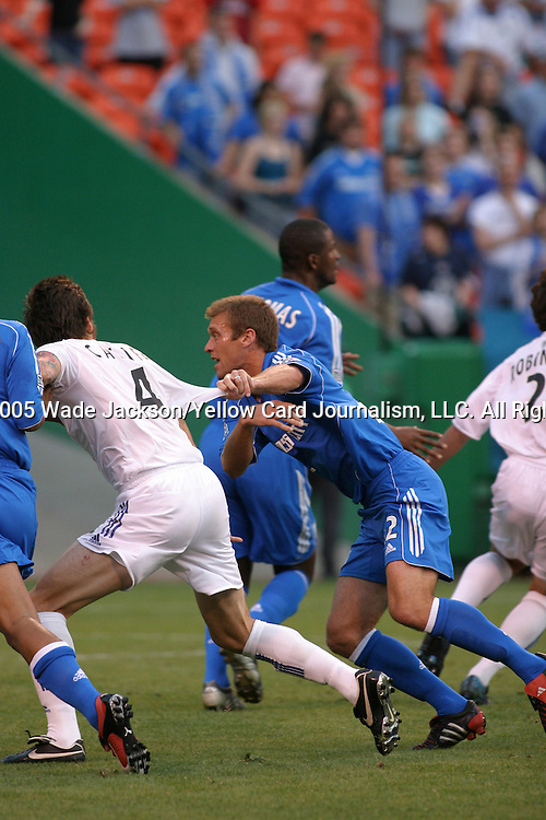 28 May 2005, Jimmy Conrad (blue) of the Wizards has ahold of sleeve of Danny Califf (4) of the Earthquakes as they scramble during a corner kick...The MLS Kansas City Wizards shut out the Earthquakes by a score of 1-0 in a hard fought regular season MLS match at Arrowhead Stadium, Kansas City, Missouri.  .. ..