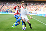 Atletico de Madrid's Yannick Carrasco and Antoine Griezmann and Sevilla's Samir Nasri during La Liga match between Atletico de Madrid and Sevilla CF at Vicente Calderon Stadium in Madrid, Spain. March 19, 2017. (ALTERPHOTOS/BorjaB.Hojas)