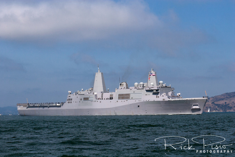 The USS Green Bay (LPD-20), a San Antonio-class amphibious transport dock, enters San Francisco Bay during the 2009 San Francisco Fleet Week Parade of Ships. Built by Northrup Grumman Ship Systems and commissioned on January 24, 2009, the ship is designed to deliver a fully equipped battalion of 800 Marines. The USS Green Bay is homeported at Naval Base San Diego and is assigned to the U.S. Pacific Fleet.