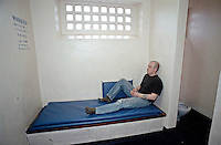 Prisoner in a prison cell. This image may only be used to portray the subject in a positive manner..©shoutpictures.com..john@shoutpictures.com