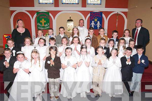 First Holy Communion Day on Saturday last as the children from Caherleaheen National School made their Holy Communion at the Immaculate Conception Church, Tralee. Front row l-r: Stephen James, Hannah Dubbin, Zoe OConnor, Ri Galwey, Sarah Gavaghan, Grainne Linnane, Tomas Leen, Andrew Kearns, Owen Moynihan and Eddie Rogers. Middle row l-r: Luke Clapham, Jessica Mackey, Meave Lynch, Jack Drinan, Ciara Quirke, Leqah Clail, Ciara Dennehy, Nicky OHalloran, Emma Pierse, Sarah Barry and Emma OConnor. Back row l-r: Lavinia Murphy, Alan McLoughlin, Tom Hoare, Mary Ann OSullivan, Donagh Broderick, Daniel Foran, Keelan Pierse and Aoife OCarroll. They are pictured with Nuala Murphy (Teacher), Fr Jerry Keane and Donal OConnor (Principal).. .