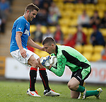 Neil Parry saves at the feet of Andy Little