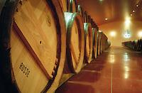 Russian oak experiment. Oak barrel aging and fermentation cellar. Chateau Carbonnieux, Pessac Leognan, Graves, Bordeaux, France
