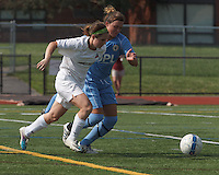 Boston Aztec forward Brittany Russo (3) on the attack as Seacoast United Mariners defender Morgan Libby (22) defends. In a Women's Premier Soccer League (WPSL) match, Boston Aztec (white) defeated Seacoast United Mariners (blue), 2-1, at North Reading High School Stadium on Arthur J. Kenney Athletic Field on on June 23, 2013. Due to injuries through the season, Seacoast United Mariners could only field 10 players.
