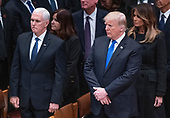 United States President Donald J. Trump, second right, first lady Melania Trump, right, US Vice President Mike Pence, left, and Karen Pence, second left, at the conclusion of the National funeral service in honor of the late former US President George H.W. Bush at the Washington National Cathedral in Washington, DC on Wednesday, December 5, 2018.<br /> Credit: Ron Sachs / CNP<br /> (RESTRICTION: NO New York or New Jersey Newspapers or newspapers within a 75 mile radius of New York City)
