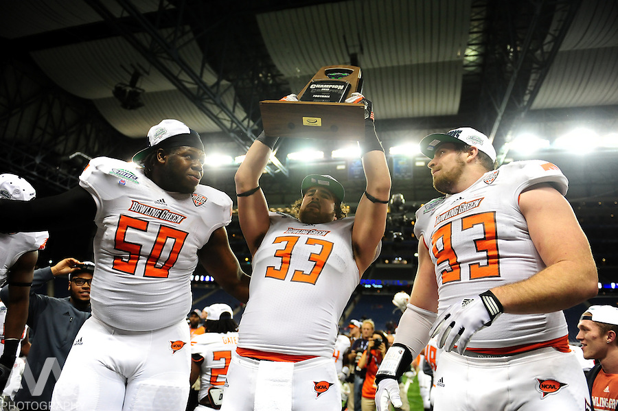 Dec 6, 2013; Detroit, MI, USA; Bowling Green Falcons defensive lineman Izaah Lunsford (50), linebacker Paul Swan (33) and defensive tackle Ted Ouellet (93) celebrate after defeating Northern Illinois Huskies 47-27 to win the MAC Championship at Ford Field. Mandatory Credit: Andrew Weber-USA TODAY Sports