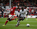 Clayton Donaldson of Sheffield Utd and Tendayi Darikwa of Nottingham Forest during the Championship match at the City Ground Stadium, Nottingham. Picture date 30th September 2017. Picture credit should read: Simon Bellis/Sportimage