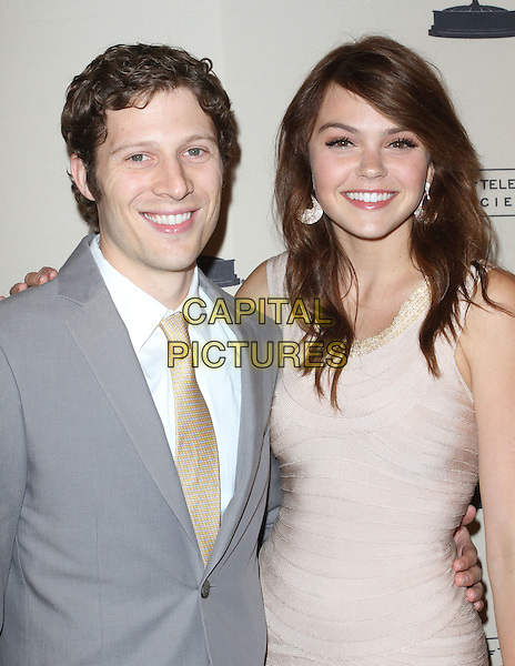 Zach Gilford & Aimee Teegarden.63rd Primetime Emmy Writers Nominee Reception Held at Leonard H. Goldenson Theatre, North Hollywood, California, USA..half length white shirt grey gray suit beige tie pink dress.CAP/ADM/KB.©Kevan Brooks/AdMedia/Capital Pictures.