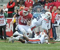NWA Democrat-Gazette/MICHAEL WOODS • @NWAMICHAELW<br /> University of Arkansas receiver Drew Morgan tries to spin away from Auburn defenders during Saturdays game October, 24, 2015 against Auburn at Razorback Stadium in Fayetteville.